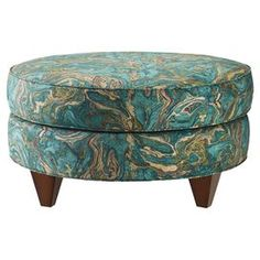 "Put your feet up in style on this marbled teal ottoman, featuring square tapered legs and cotton upholstery.   Product: Cocktail ottomanConstruction Material: Polyurethane foam, polyester fiber, cotton and woodColor: Marbled tealFeatures:  Square tapered legsMade in the USADimensions: 17"" H x 30"" Diameter"