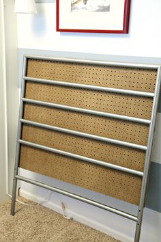 How to make an upholstered headboard from a metal headboard: IHeart Organizing: Boy's Bedroom Upholstered Headboards