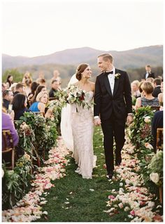 Happy newlyweds. Bride and groom after their wedding on the Ceremony Lawn at Pippin Hill Farm & Vineyards near Charlottesville, VA. Autumn florals by Beehive Events. Image by Eric Kelley.