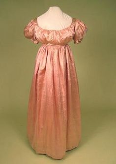 Pink silk gown 1790s...the shape is already changing toward the empire waist fashions of the early 19th century.