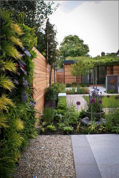 Green Wall within a contemporary garden in London, designed by Anoushka Feiler / Bestique.