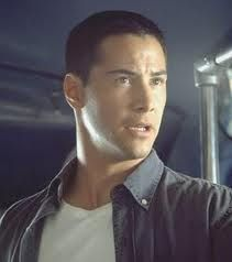 Keanu Charles Reeves (1964) is a Canadian actor known for his roles in Bill & Ted's Excellent Adventure, Speed, Point Break, and The Matrix trilogy as Neo.