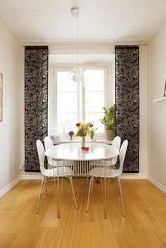 Dining chairs- lose the table, and replace it with something wood and dark