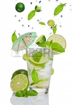 Fresh mojito drink with falling limes into glass. Isolated on white background