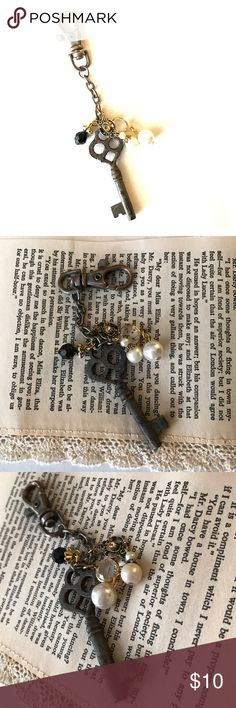"""Antique skeleton key keychain This keychain features an actual antique/vintage skeleton key. Accented with pieces from vintage jewelry. Key shows rust and wear from age. Very cool and unique piece, one of a kind! Measures a little over 5"""" long. Vintage Accessories"""