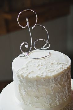 """a silver scroll """"B"""" makes a simple yet elegant wedding cake topper - thereddirtbride.com - see more of this wedding here Initial Decor, Barn Parties, Elegant Wedding Cakes, Wedding Cake Toppers, Vanilla Cake, Simple, Party, Desserts, Silver"""