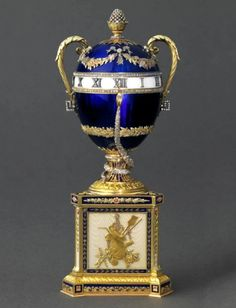 Blue Serpent Clock Egg, 1887. Presented by Alexander III to Czarina Maria Fyodorovna. Gold, opalescent white enamel, diamonds, sapphires. Kept in Prince Ranieri II of Monaco Collection.