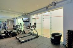 Home exercise room with full view of gym... luxury living for the 1%.