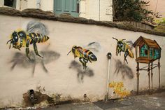 Bees by Louis Masai.   I LOVE This idea and plan to do something like this on my fence this summer with Bumblebees. Tdeb:)