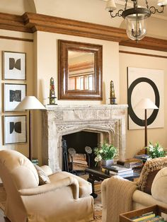 Three black and white prints and painting from Lacy Primitive and Fine Art. Room is library at Greystone Estate, Beverly Hills by David Phoenix and Rose Tarlow. Photo by Peter Vitale. From Veranda.