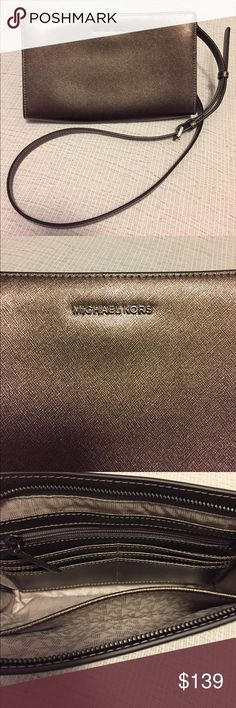 Michael Kors brown pewter Large Crossbody Clutch MICHAEL Michael Kors Large Crossbody Clutch  This crossbody was only used a couple of times and is in LIKE NEW condition!! It is a very pretty, brown/pewter in color. There are lots of pockets in the main compartment and a magnetic closure pocket on the back/outside of the bag. Please refer to the pic of the description for more information. MICHAEL Michael Kors Bags Crossbody Bags