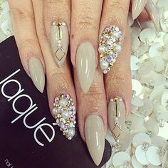 Nude stiletto nails with pearls and bling!