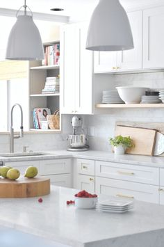 This stunning white kitchen highlights how one color can still have great design, dimension and interest.