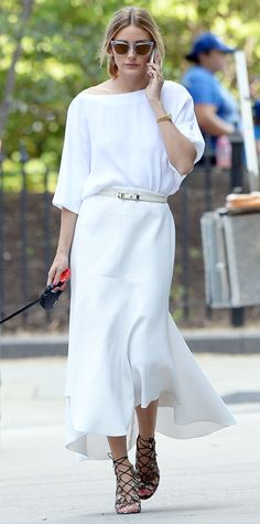 Olivia Palermo took Mr. Butler out for a stroll in stark white separates, teaming her relaxed-fit top and midi-length skirt with a skinny white belt, shades from her Westward Leaning collection and lace-up sandals.