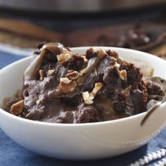 Ooey gooey chocolate pudding, caramel and pecans make this slow cooker dessert extra delicious