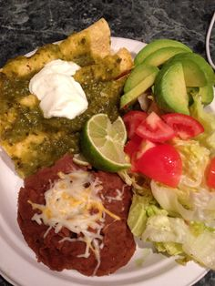 600 calorie dinner- light cheese green enchiladas, refried beans, avocado, and salad Much healthier than my favorite Mexican restaurant