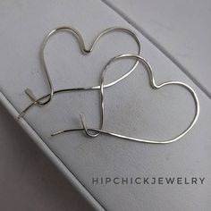 Handmade heart shaped hoops is a trending takke on a wardrobe classic. I shaped these from Sterling wire and gently hammered then to produce a slightly flat look and then shined to catch the light.    These heart shaped hoops come in 14 kt Gold Fill, 14 kt Rose Gold or Sterling Silver. Please specify which color and material you would like upon ordering.    Each piece is made to order. Please allow for slight variations in the creative process. If you would like images of the finished pairs…