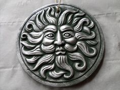This is a lovely wall plaque of the green man! It is silver in colour and comes complete with rope to hang on the wall, a real symbol of the wild wood and fertility.   £14.00, including postage and packaging.   http://www.greengoddessearth.co.uk/