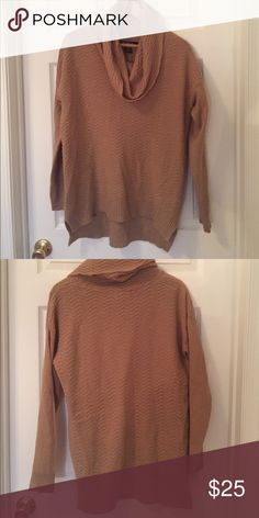 Slouchy camel colored sweater This slouchy camel colored sweater is great with a pair of dark jeans and heels. Worn only a couple of times and still has a ton of life in it! Sweaters Cowl & Turtlenecks