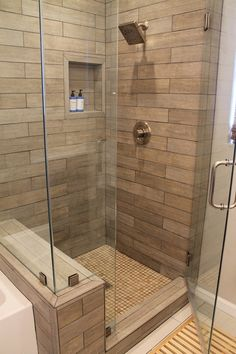 Inspiration of the day: Lighter shade wood tile in shower making your bathroom rustic amid modern home style.