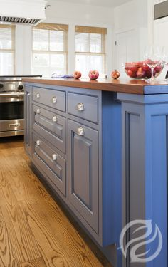 Islands are currently the single most popular design element in today's kitchen. Add a breakfast bar, extra shelving, appliance storage, the possibilities are endless! #GreenfieldCabinetry #CustomCabinetry #KitchenIsland #Picture #Image