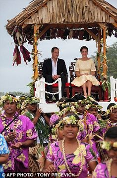 King and Queen for the day: William and Kate are carried on thrones after their arrival at Funafuti in Tuvalu today