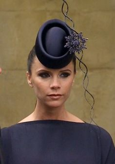 She got a bit of flak for it, but I loved Victoria Beckham's headpiece (and outfit) that she wore to the Royal Wedding... what were your thoughts?