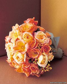 In this vivid version of the single-color bouquet, spray roses, garden roses, and viburnum berries recall the oranges of a sunset. A swath of smoky-teal Ultrasuede secured with a vintage buckle dresses the stems. Bridal Bouquet Fall, Rose Wedding Bouquet, Fall Bouquets, Rose Bouquet, Bridesmaid Bouquet, Bridal Bouquets, Orange Flower Bouquets, Orange Wedding Flowers, Wedding Colors