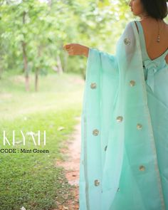 Define your summer look in our hand embroidered dreamy Mint Green Silk Organza Saree paired with Raw silk Blouse piece.