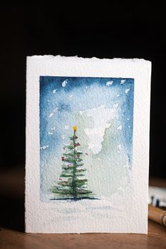 These are hand painted watercolor Christmas cards, complete with envelopes. Each card is painted by hand, NOT A PRINT or reproduction. Each one will vary, some will have deckled edges ( they are cut from a large sheet of paper ).  This series features a tree in night time snowy sky. The cards are painted on thick Arches watercolour paper, one at a time.  The cards are A1 in size ( 5 x 3.5 inches )  Shipping is through Canada post and generally takes a couple days for most of the eastern…