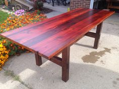 Harvest table made from reclaimed old growth pine boards. This one is 34 inches wide by 7 feet long.
