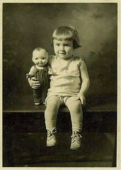 Vintage photo of little girl with her doll