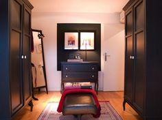 Vintage Elegant Dressing Room With Black Leather Bench And Black Vintage Wardrobe Also Black Vintage Chest Of Drawers And Moroccan Rug Design Ideas: Elegant Eclectic Penthouse Design in Cologne by Angelo de Bock