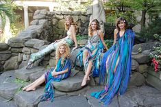 """""""Models dressed in mermaid costumes from Malabar posed for photos beside the courtyard fountain."""""""