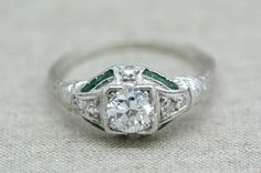 Antique Edwardian / Art Deco .70ct Old European Cut Diamond and Emerald Engagement Ring in Platinum with Engraving and Milgrain