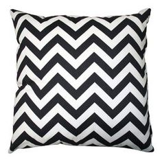 """Indoor/outdoor chevron pillow in black.   Product: PillowConstruction Material: PolyesterColor: Black and whiteFeatures: Insert includedChevron front and solid reverseDimensions: 18"""" x 18""""Cleaning and Care: Spot clean. Cover can be machine washed and air dried."""