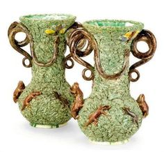 A PAIR OF PORTUGUESE PALISSY-STYLE FAIENCE TROMPE L'OEIL VASES,  IMPRESSED MARK FOR MAFRA & SONS (CALDAS) , LATE 19TH/20TH CENTURY,  with applied lizards, snakes, toads, and winged insects on a grass ground  13¼in. (33.7cm.) high (2)