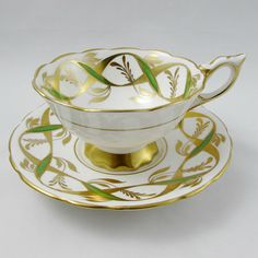 Made by Royal Stafford, tea cup and saucer have a pattern of green and gold ribbons. Gold trimming on cup and saucer edges. Excellent condition (see photos). Markings read: Royal Stafford Bone China Made in England Est 1845 Please bear in mind that these are vintage items and there