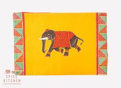 Stunning Indian Inspired Elephant Placemats Yellow / Red - New & Unique  I am really pleased to showcase some new placemats that we have created, with material directly sourced from Jaipur in Rajasthan, India. The elephant has taken inspiration from ancient India and the times of the British Raj. Very vibrant red and yellow, and they make a great addition to any table. They have red backs so they are reversible, and ideal for Christmas also.