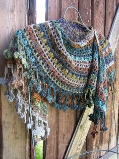 Crochet Noro shawl 3 by yarn jungle, via Flickr i like these colors together.