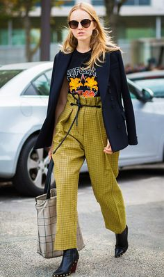 Tee outfit idea—pair a graphic tee with statement pants, a draped blazer, and black booties.