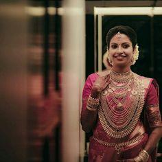 Image may contain: 1 person, standing Indian Bridal Sarees, Wedding Silk Saree, Indian Bridal Outfits, Indian Bridal Wear, Indian Wedding Pictures, Indian Wedding Bride, South Indian Bride, Malayali Bride, Kerala Engagement Dress
