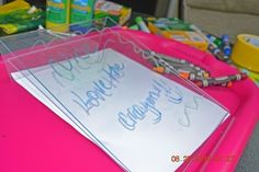 Plastic picture frame and dry erase markers or crayons- great way to practice writing!