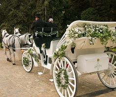Roses and greenery adorn the seats, wheels and canopy of the carriage that transported the happy couple from ceremony to reception.