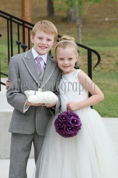 Ring bearer and flower girl, brother and sister, the best wedding pic I've ever seen.