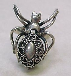 Vintage Sterling Silver Poison Ring ~ SPIDER - i have one of these....mine has ruby eyes...one of my fav rings....but yet i dont wear jewelry...i suppose beware if i am wearing this when cooking :)