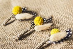 """Feathers and """"Billy Buttons""""...love the idea of using like a pink button!!"""