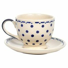 Enjoy steaming tea or piping hot chocolate with this charming cup and saucer, showcasing a delightful polka-dot motif and ceramic design.