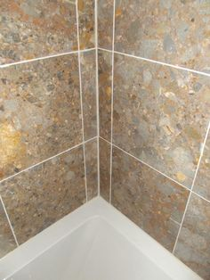 Marble wall tile detail with 'ivory' grout and 'jasmine' mastic sealant.  http://www.ppmsltd.co.uk