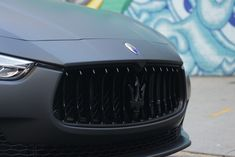 Maserati Quattroporte with matte black wrap with gloss trim, logo and accents. Matte Black Wrap, Maserati Quattroporte, Custom Wraps, Vehicles, Vehicle